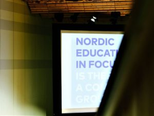 "Picture of conference room, showing screen with text ""Nordic Education in Focus"""