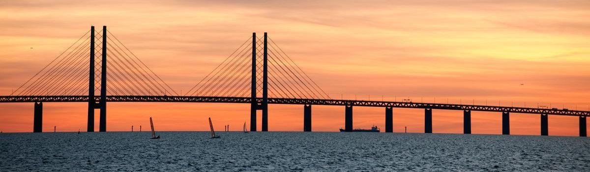 Silhouette photo of Bridge of Öresund in sunset.